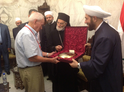 Bill Stanley receives a gift from Dr Hassoun (the Grand Mufti of Syria)