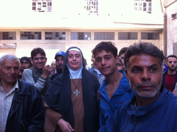 Joined by Sister Carmel and two members of her team, Mother Agnès-Mariam is welcomed by the men of the revolution came without their weapons.