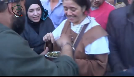 Eating together olives (the unique vegetable available in the besieged city) as a sign of peace