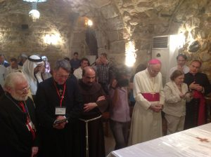 with Syrian church leaders in the home of Ananias in Damascus, praying for peace