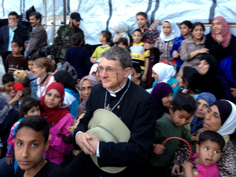 Father Dave with refugees from Yarmouk (April 2014)
