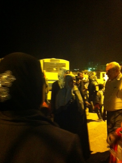 Volunteers and Governorate personnel welcome the evacuated civilians in Qoudsiyya guest house.