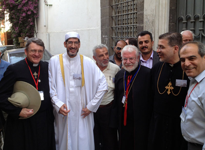 local community leaders in Damascus, working together for peace