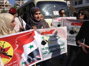 peace activists greet us in Latakia